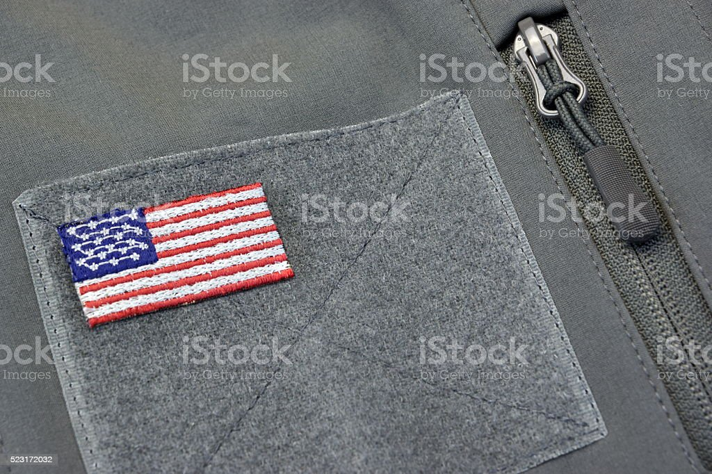 Coat With American Flag Patch And Silver Zipper stock photo