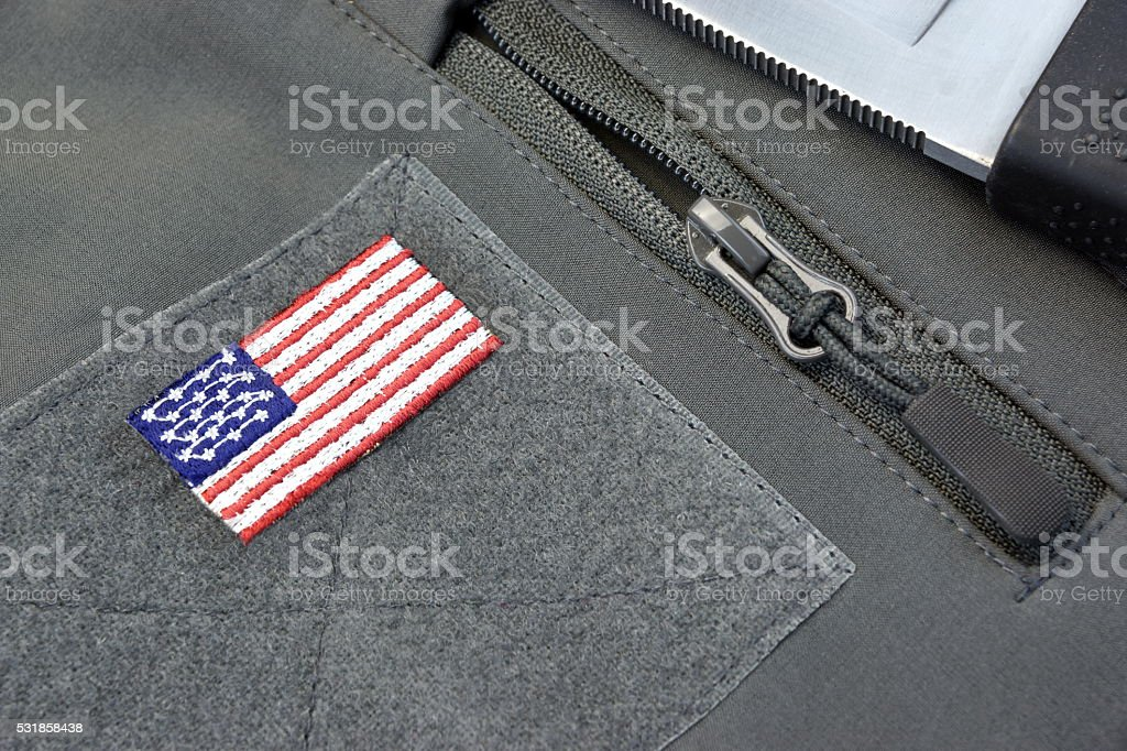 Coat With American Flag Patch, Silver Zipper And Battle Knife stock photo
