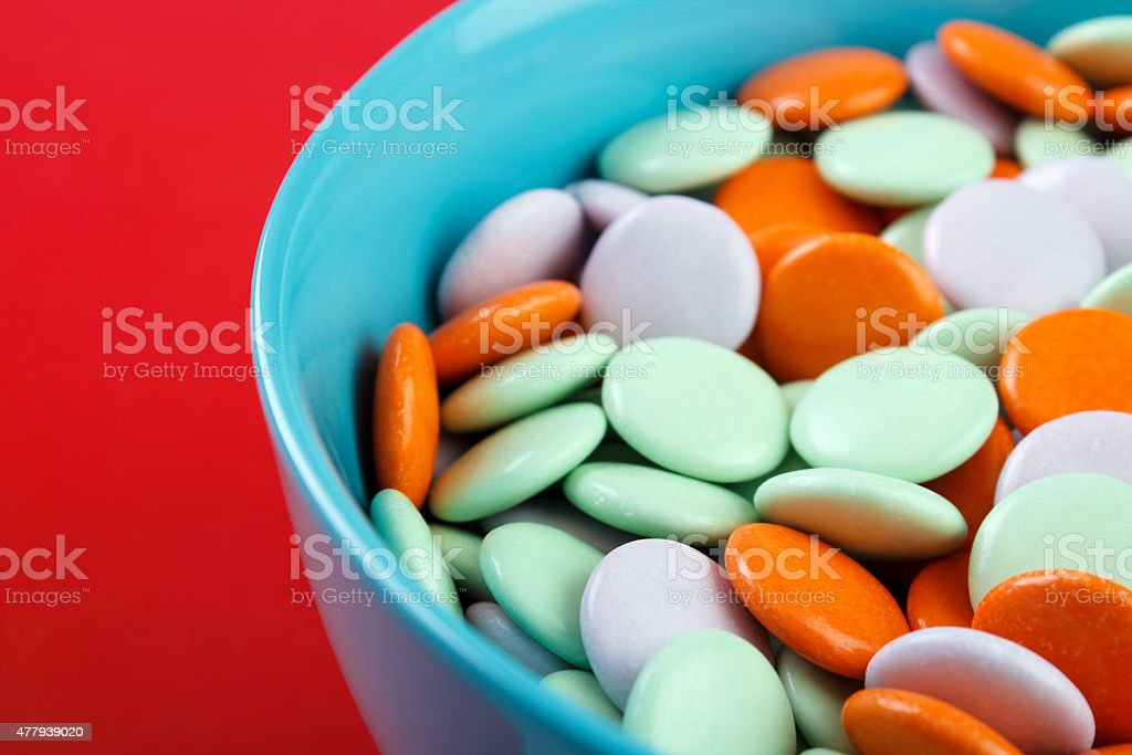 Coated candies on bowl royalty-free stock photo