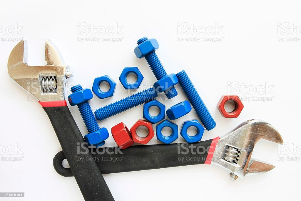 Coated stud bolts and nuts with wrench stock photo