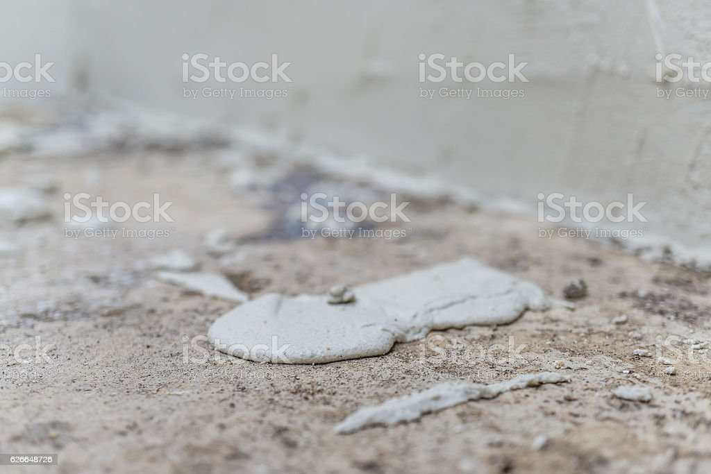coating cement dropped goop on the floor in works stock photo