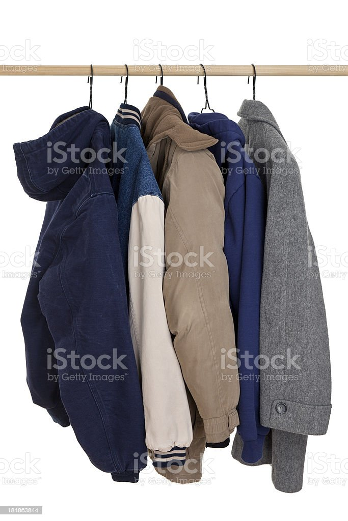 Coats Hanging on Rack stock photo