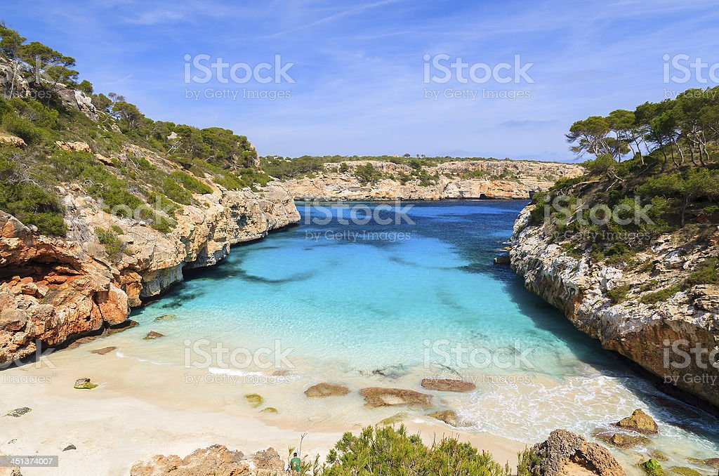 Cobalt blue inlet from sea & blue sky in Cala des Moro  stock photo