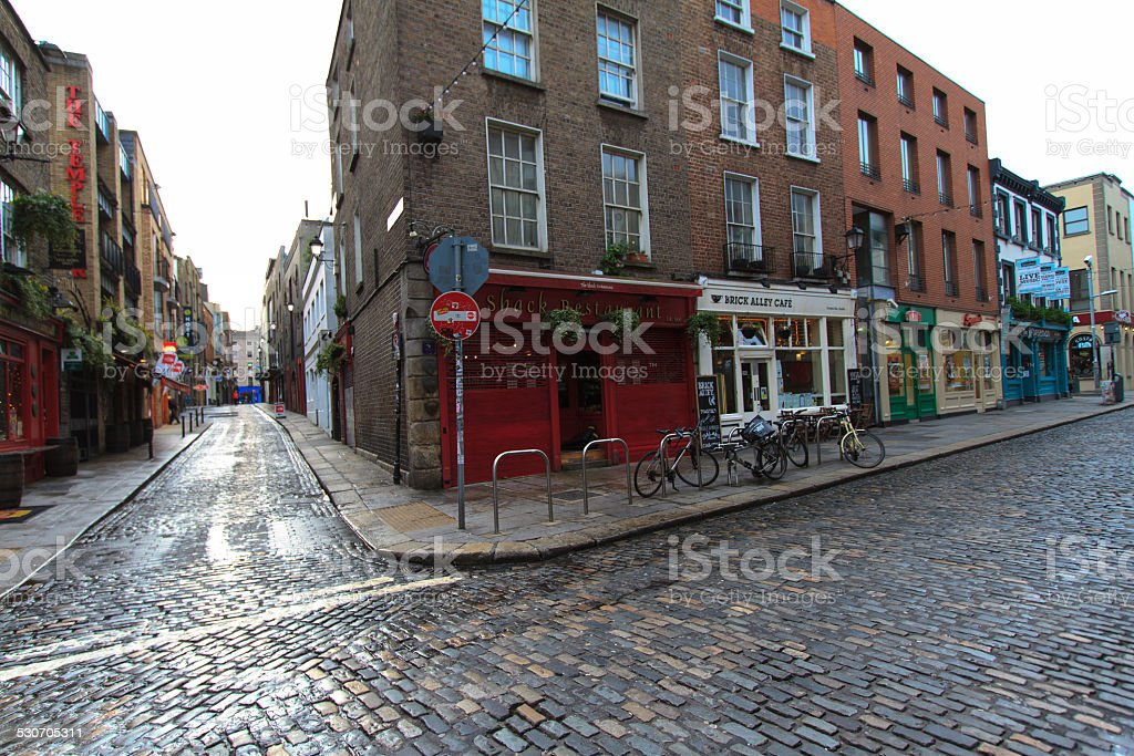 Cobbled Intersection with Shops, Pubs and Bikes, Dublin stock photo