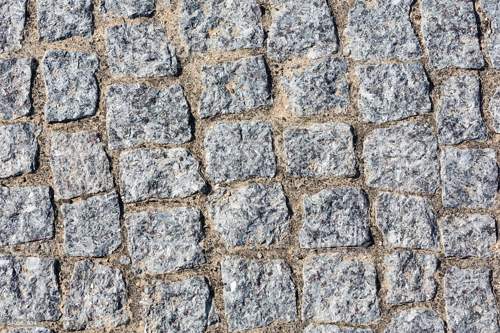 Cobbled road as background. stock photo
