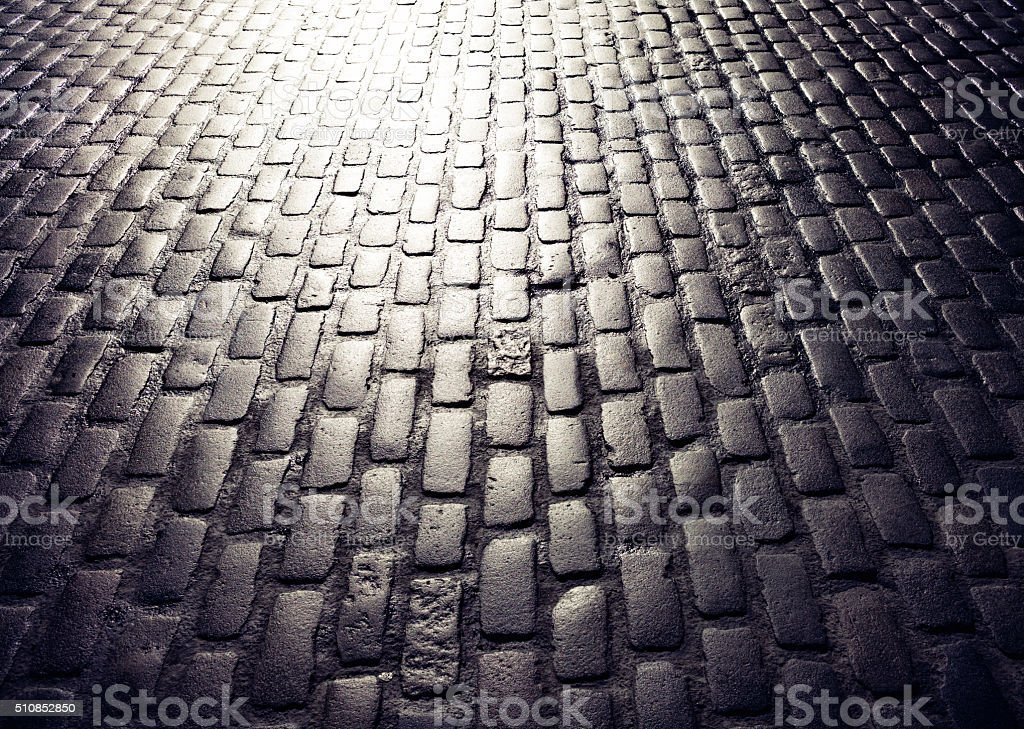 Cobbled road perspective background stock photo
