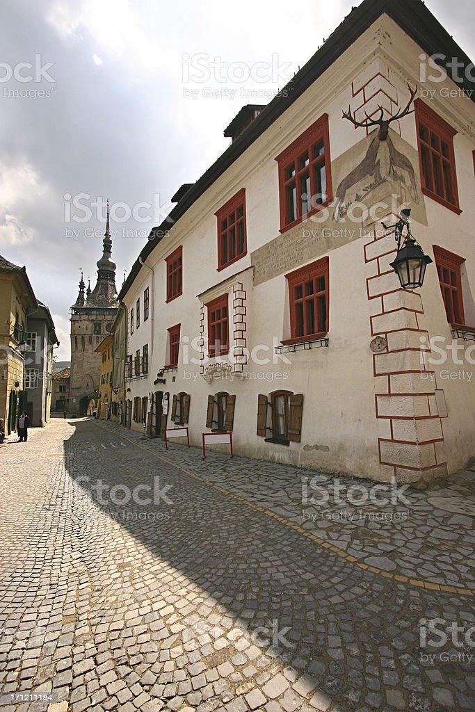 Cobbled Street and Clock Tower in  Sighisoara, Romania royalty-free stock photo