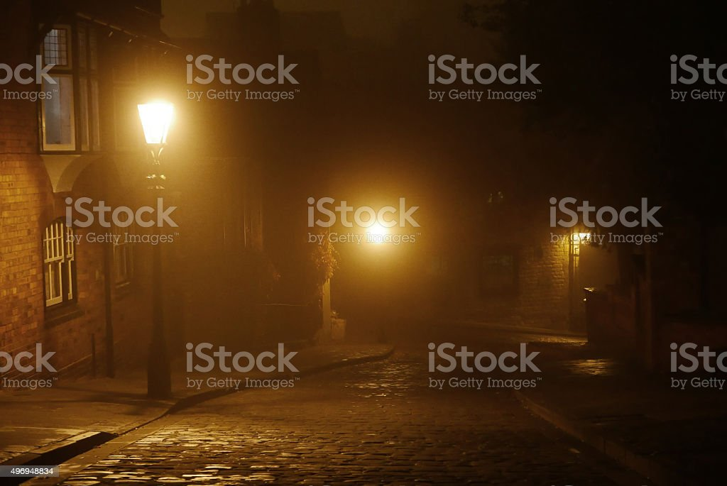 Cobbled Street, at night in the fog (Lincoln, UK) stock photo