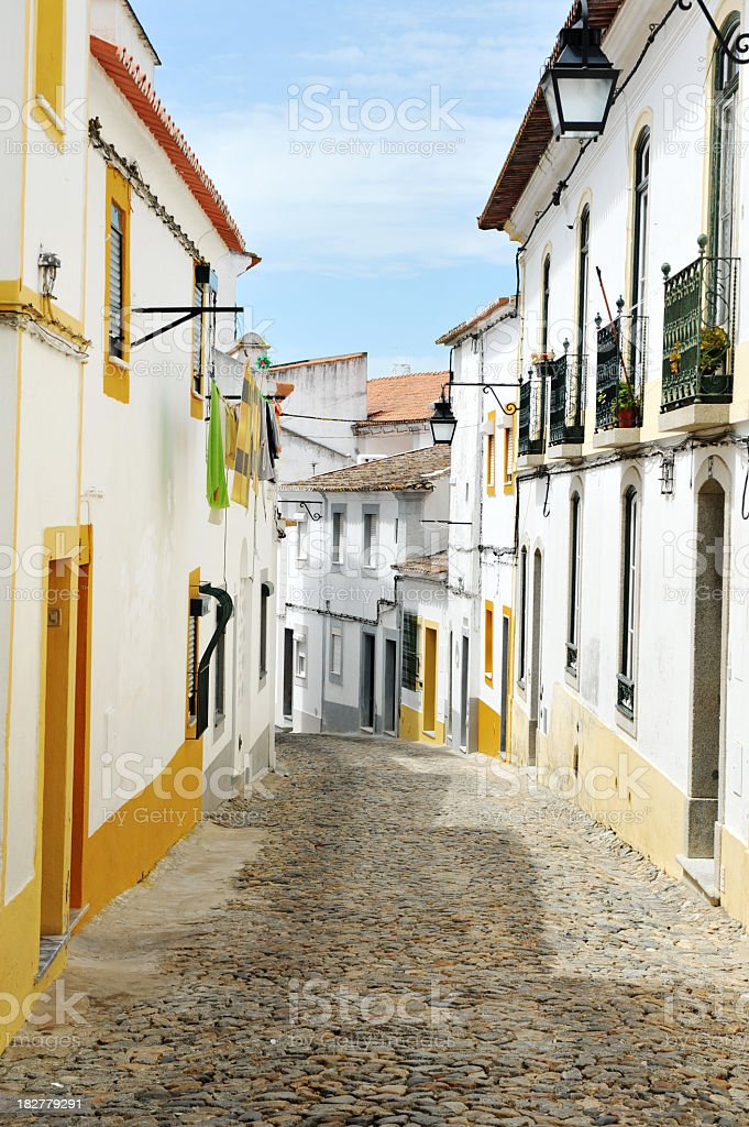 Cobbled street in old town, Evora, Portugal stock photo