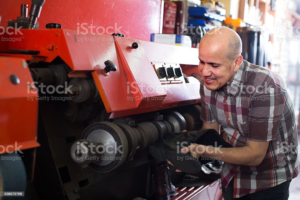cobbler polishing shoes stock photo