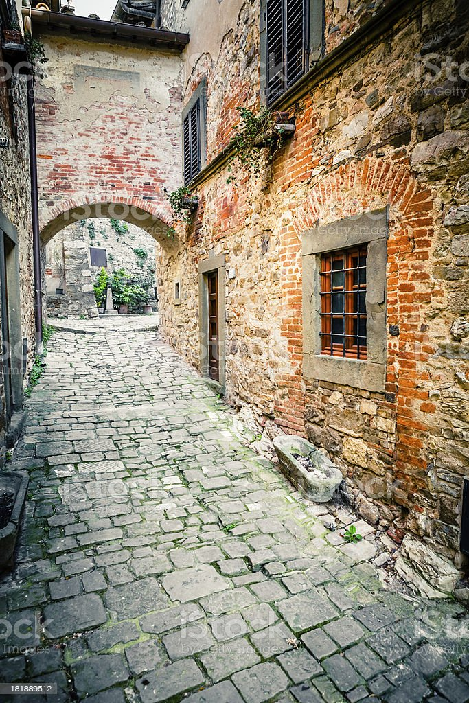 Cobblestone Alley in Ancient Tuscan Village, Italy royalty-free stock photo