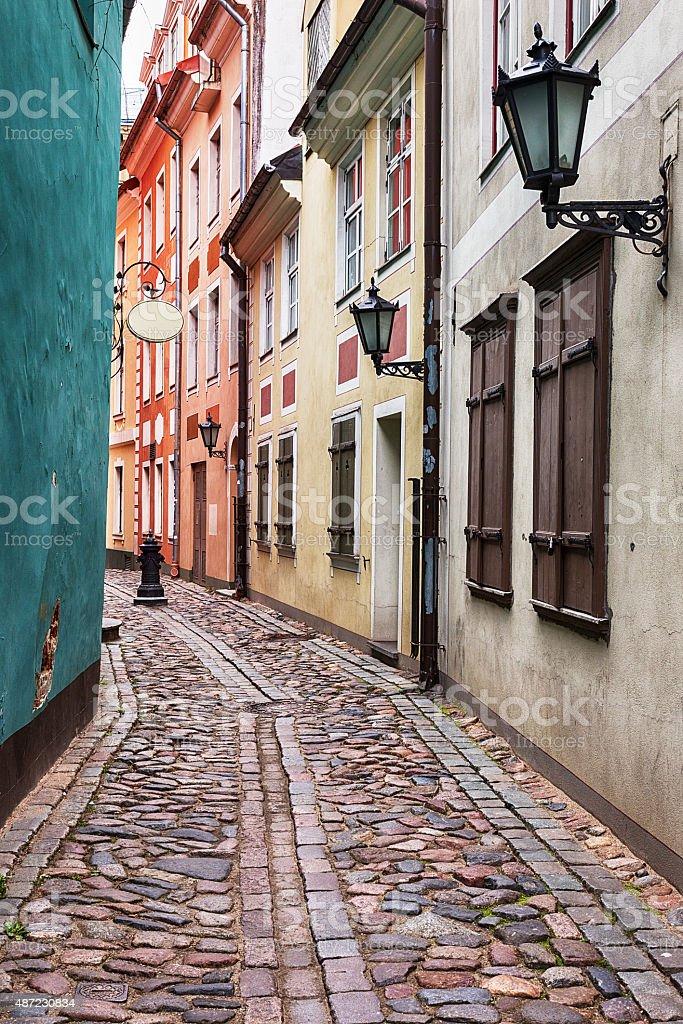 Cobblestone alley in Riga, Latvia. stock photo