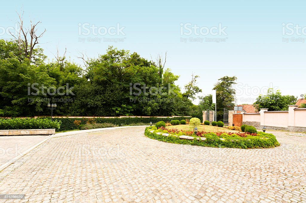 Cobblestone driveway in front of a villa stock photo
