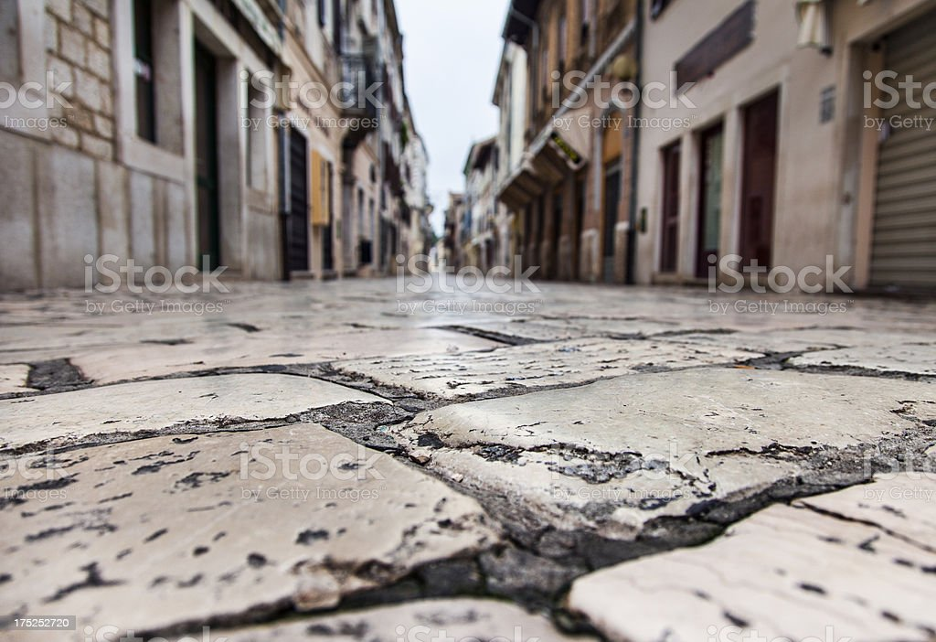 Cobblestone paved street royalty-free stock photo