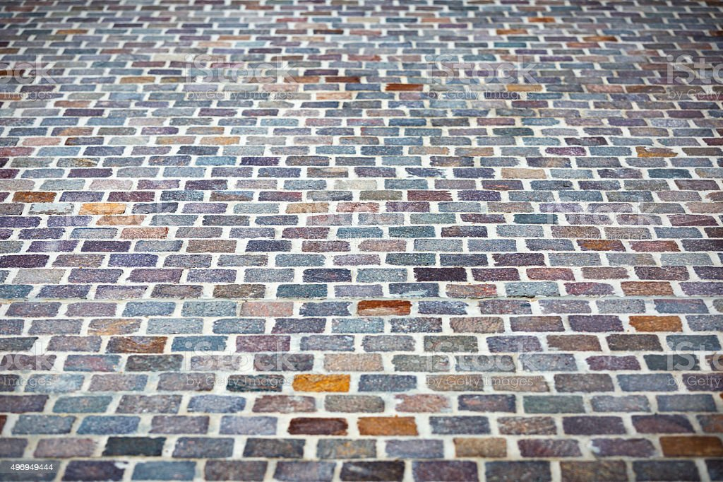 Cobblestone pavement, background with copy space and vignette stock photo