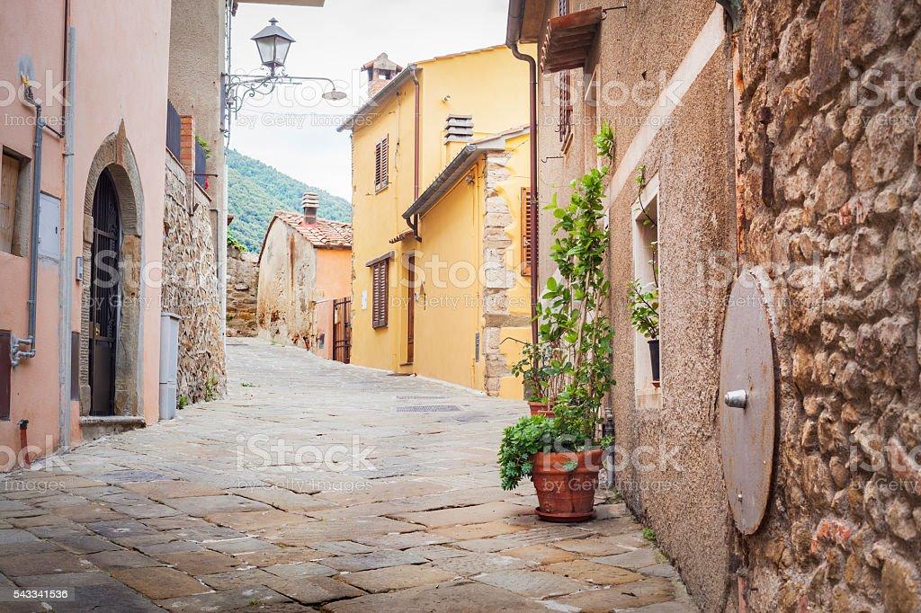 Cobblestone Road In Medieval Village, Tuscany Italy stock photo