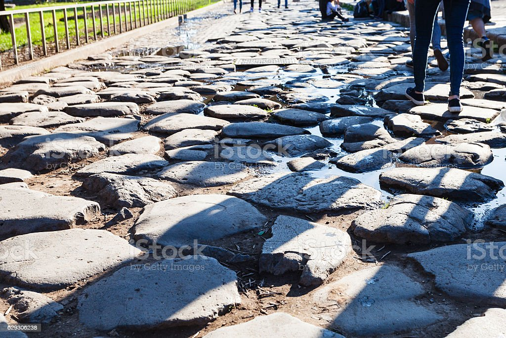 cobblestone road in the end of ancient Appian Way stock photo