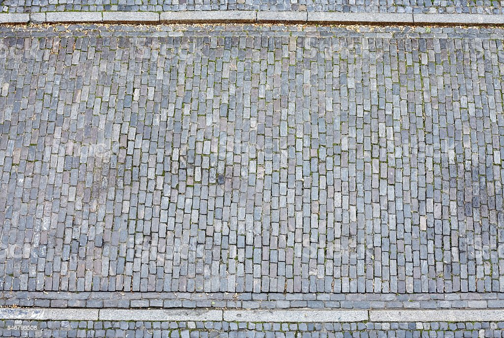 Cobblestone street and pavement from above stock photo