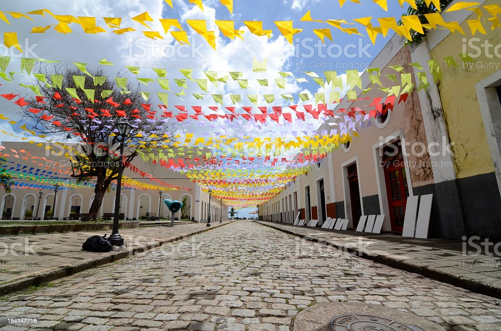 A cobblestone street decorated for a festival stock photo