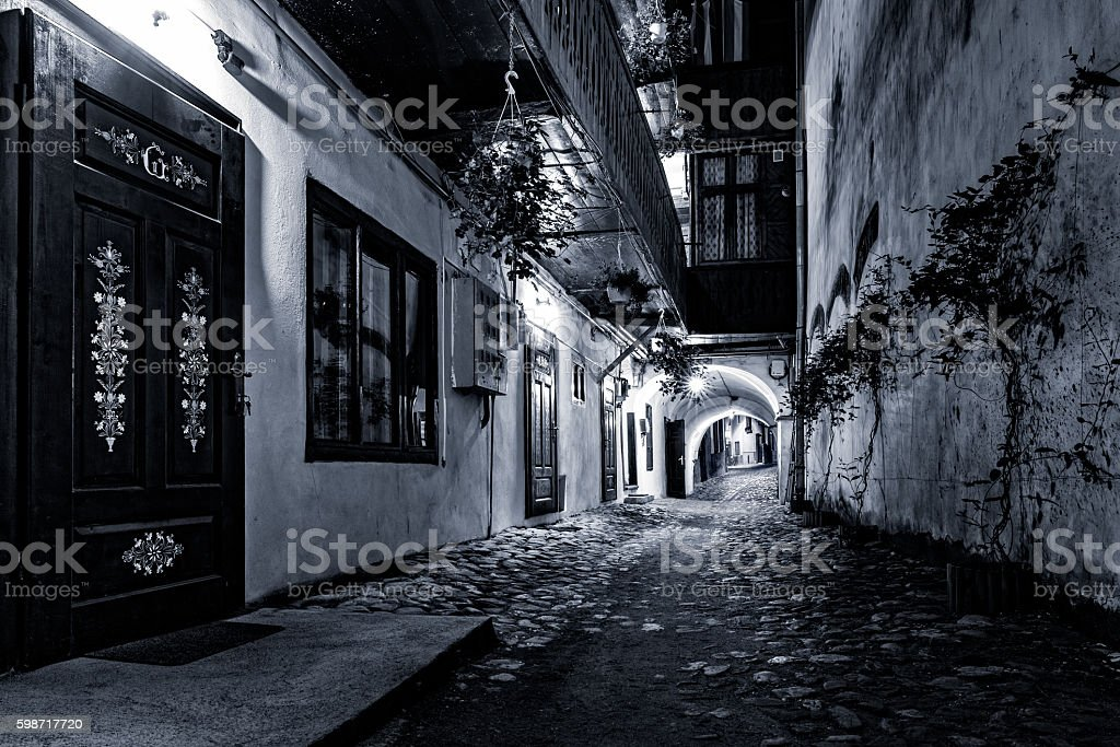 Cobblestone street passage in Sibiu, Romania stock photo