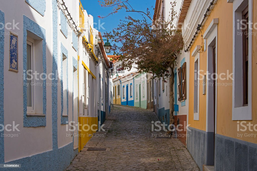 Cobblestone street with colorful houses stock photo