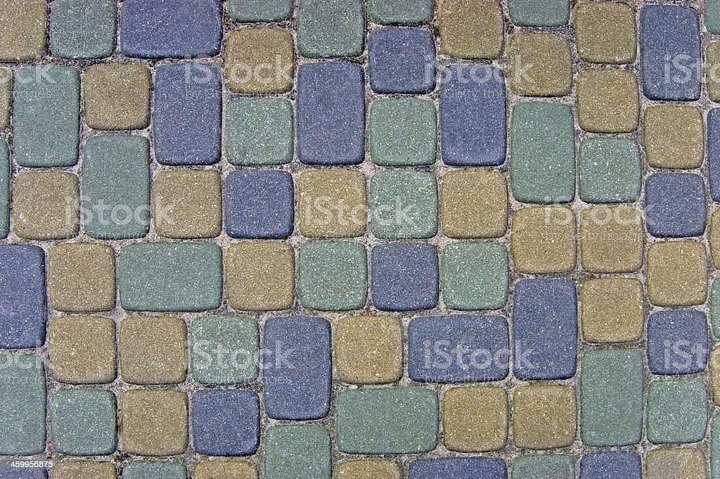 Cobblestone Texture Background Closeup colorful green, yellow, blue, beige cobbles royalty-free stock photo