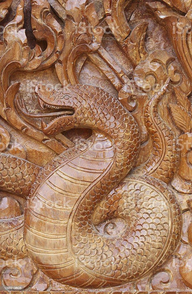 Cobra on the temple door. royalty-free stock photo