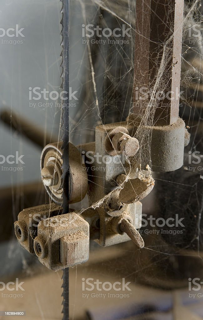 Cobwebs and abandoned machinery stock photo