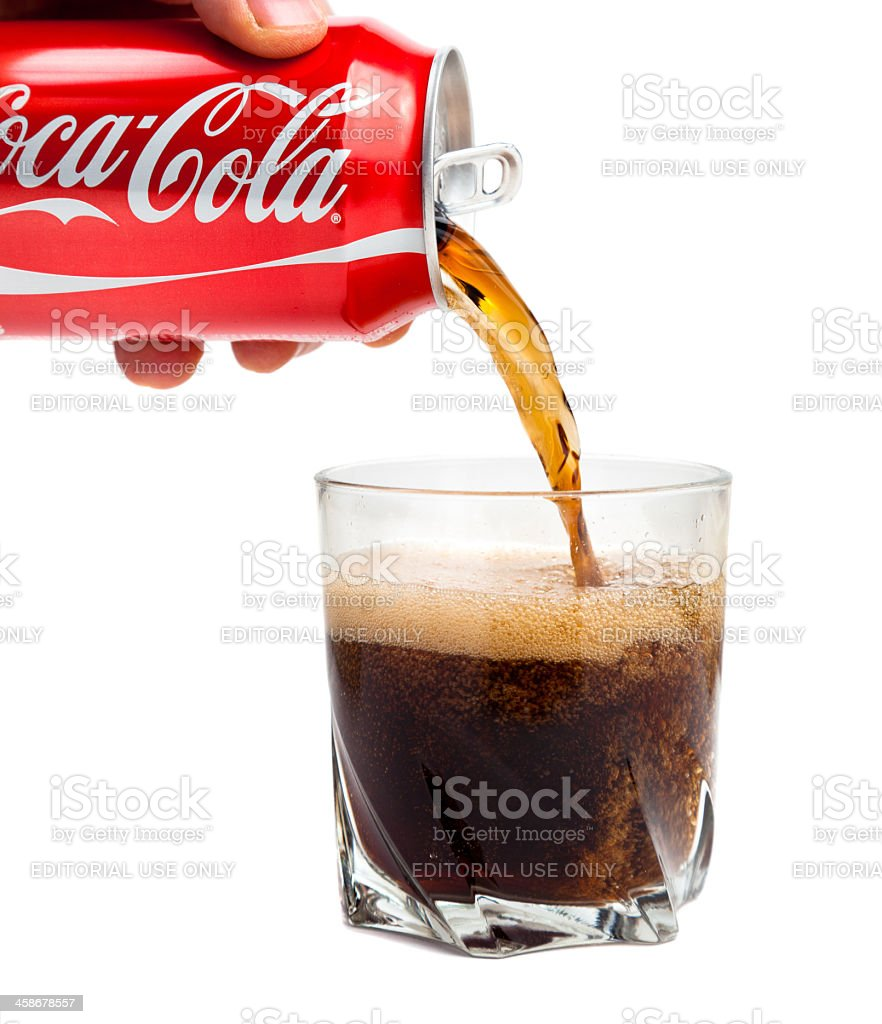 Coca Cola pouring into glass. Isolated on white background royalty-free stock photo