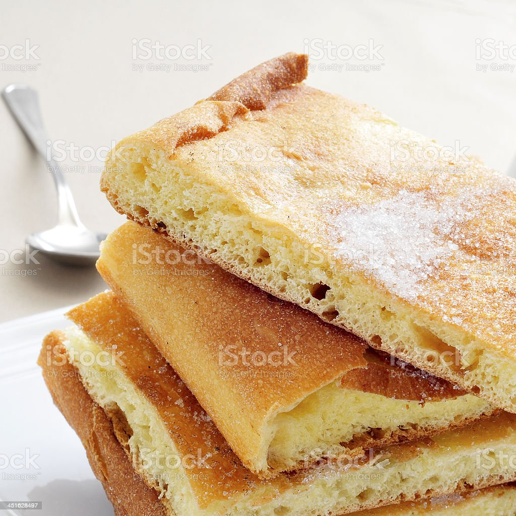coca de sucre, typical sweet flat cake from Catalonia, Spain stock photo