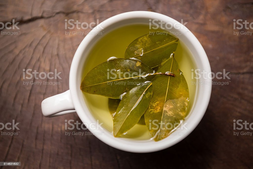 Coca tea infusion in white mug stock photo