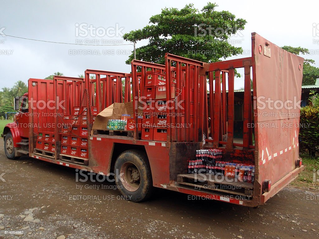 Coca-Cola Delivery Truck drops off drinks to rural town stock photo
