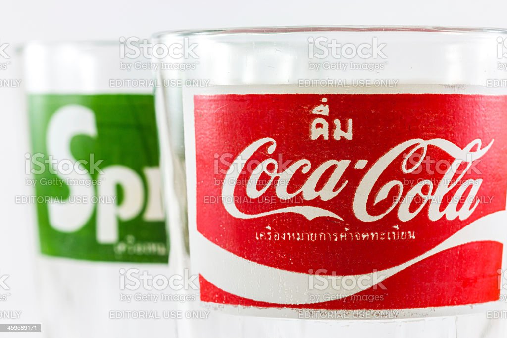 Coca-Cola foreground and Sprite background classic logo on empty glass royalty-free stock photo