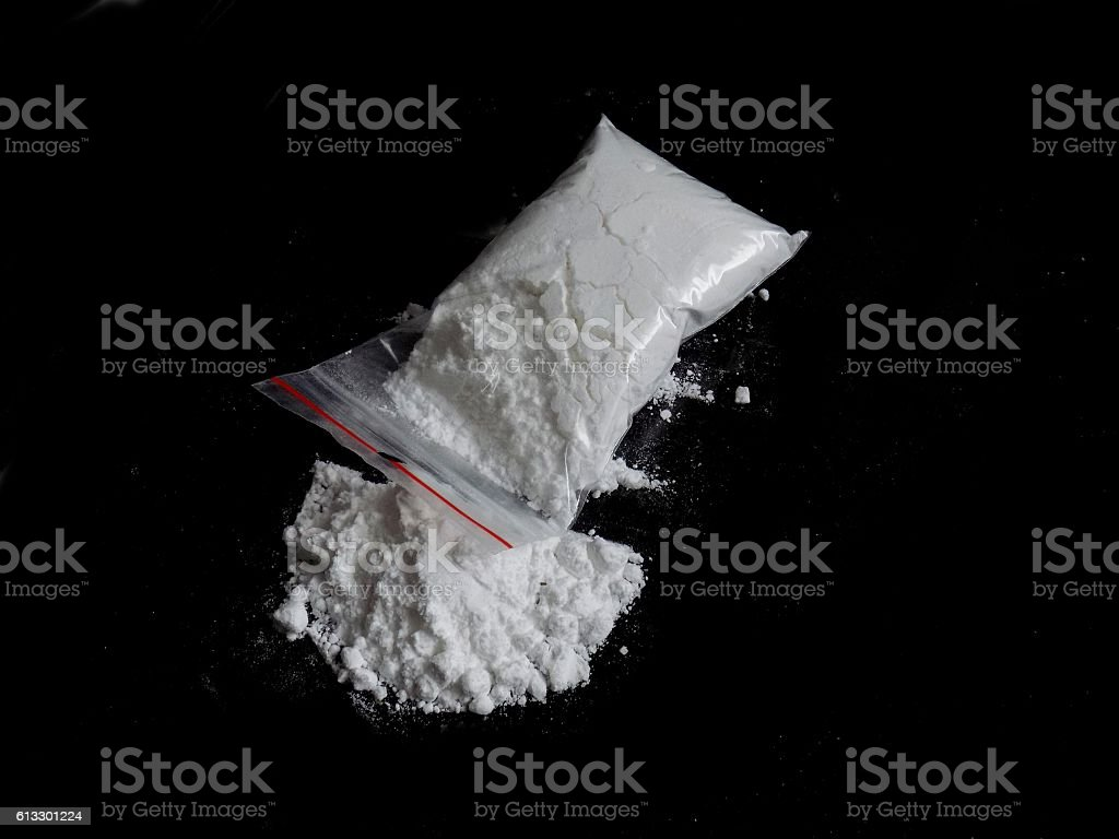Cocaine drug powder in bag and cocaine powder pile stock photo