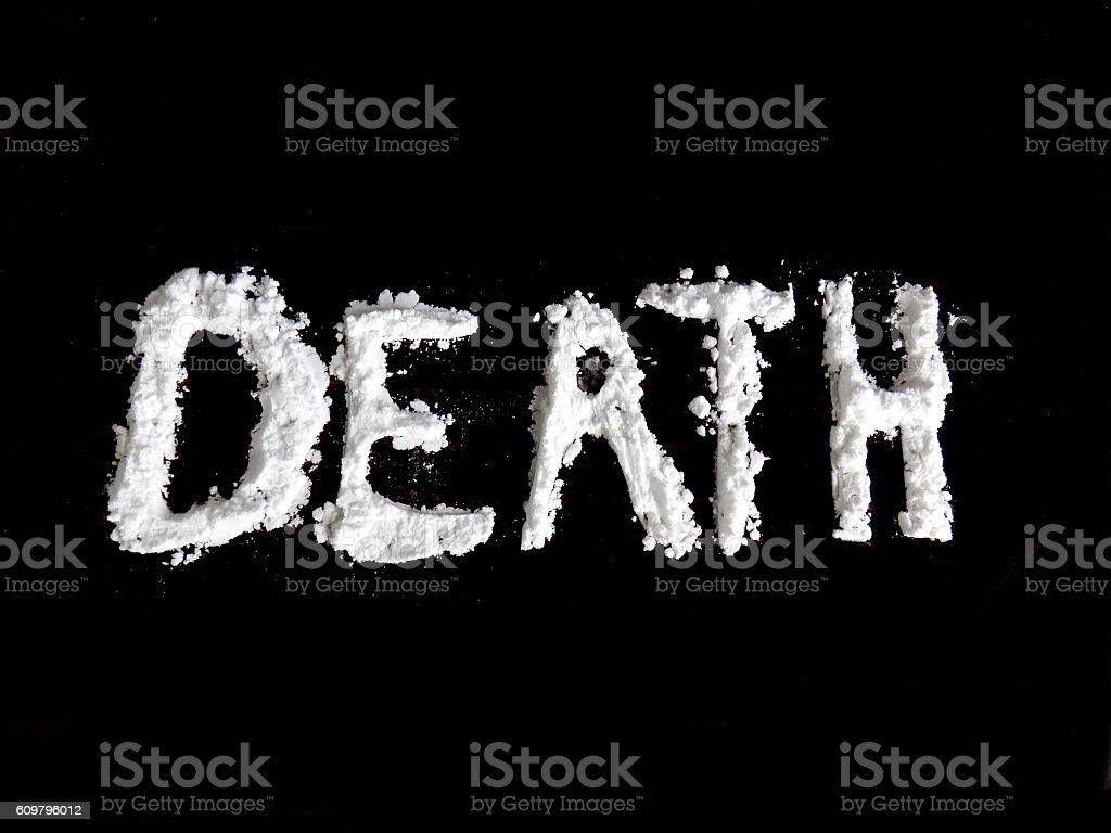 Cocaine drug powder in shaped word death stock photo