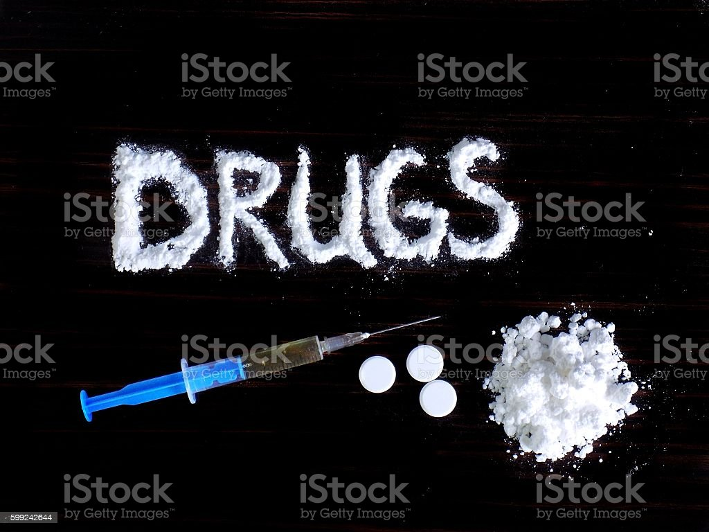 Cocaine drug powder, injection and pills stock photo