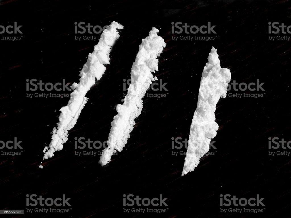 Cocaine drug powder on black background stock photo