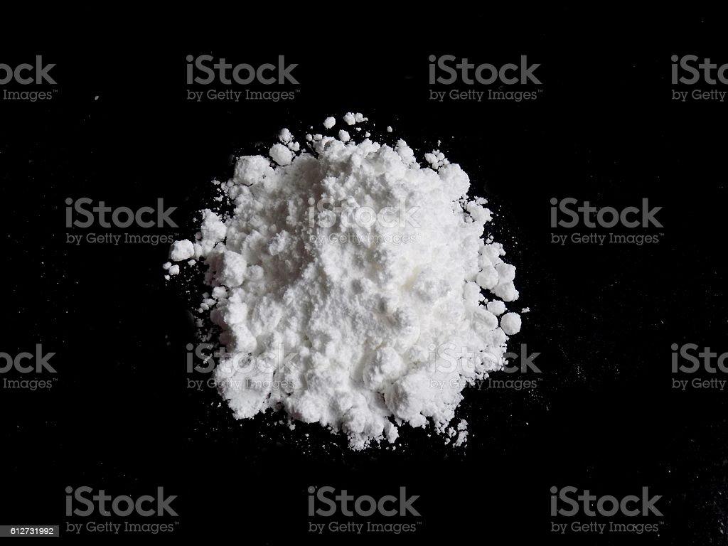 Cocaine drug powder pile on black background stock photo