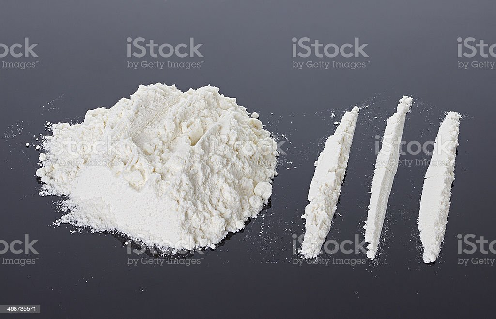 Cocaine on a black background stock photo