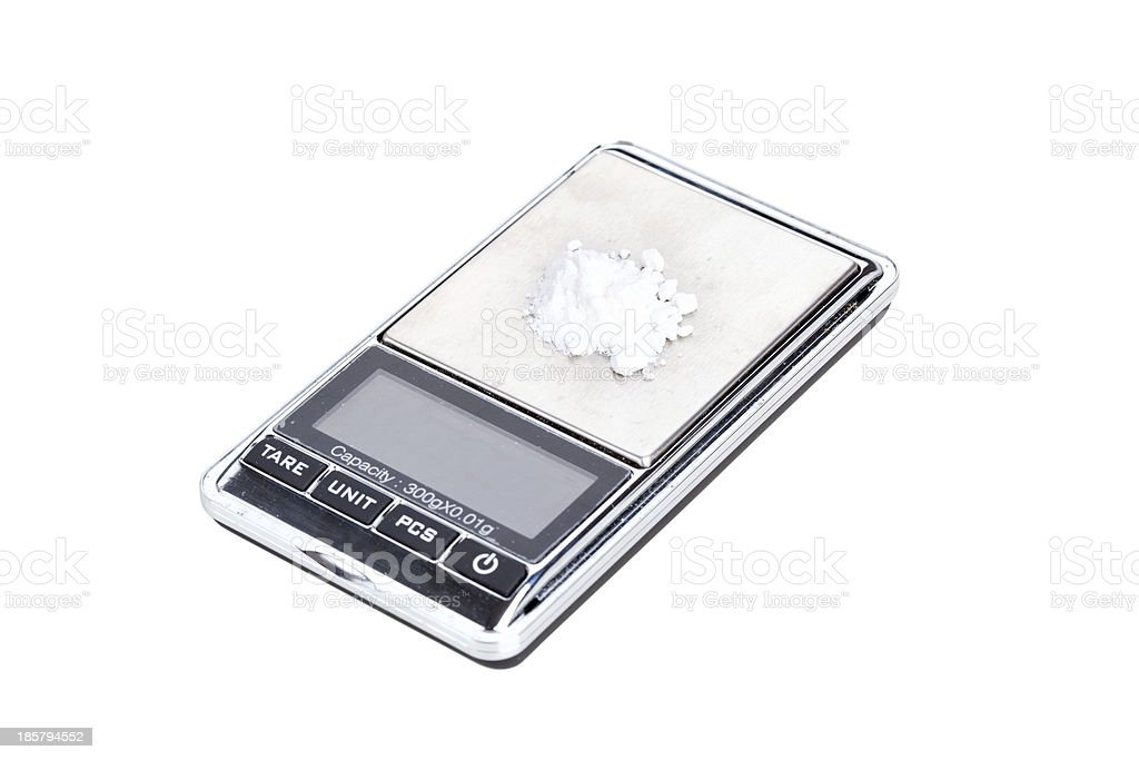 Cocaine on digital scales stock photo