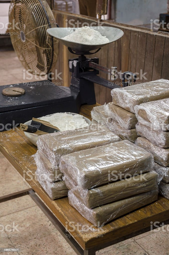 Cocaine packets being weighted stock photo
