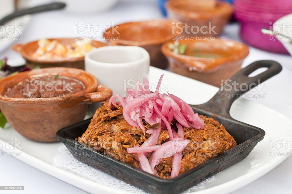 Cochinita pibil or marinated shredded pork meat stock photo