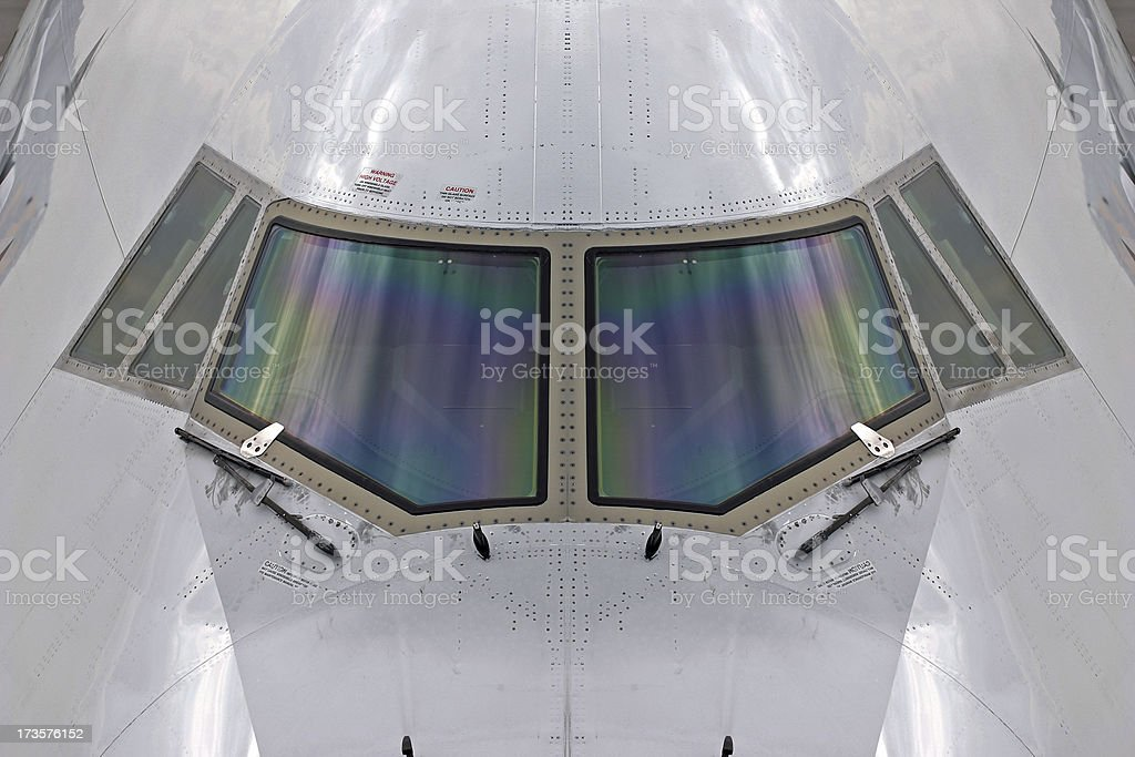Cockpit nose of airplane, symmetric stock photo