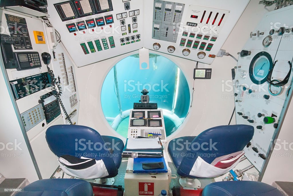 cockpit of a submarine with dashboard full of gauges stock photo