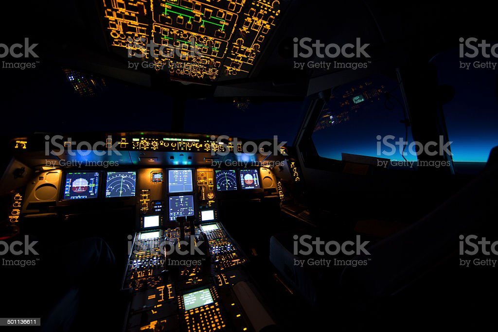 Cockpit of aircraft at sunrise or sunset stock photo