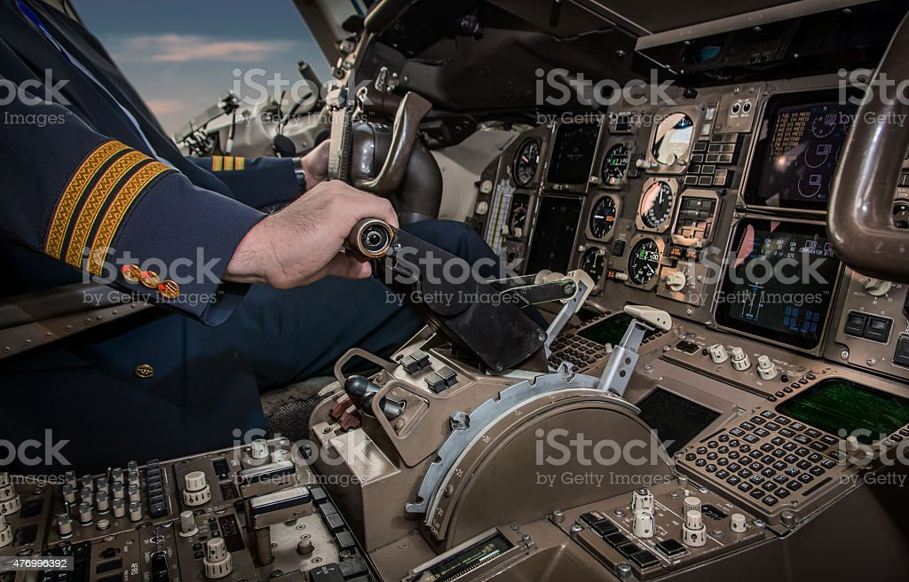 Cockpit of an airplane during a flight stock photo