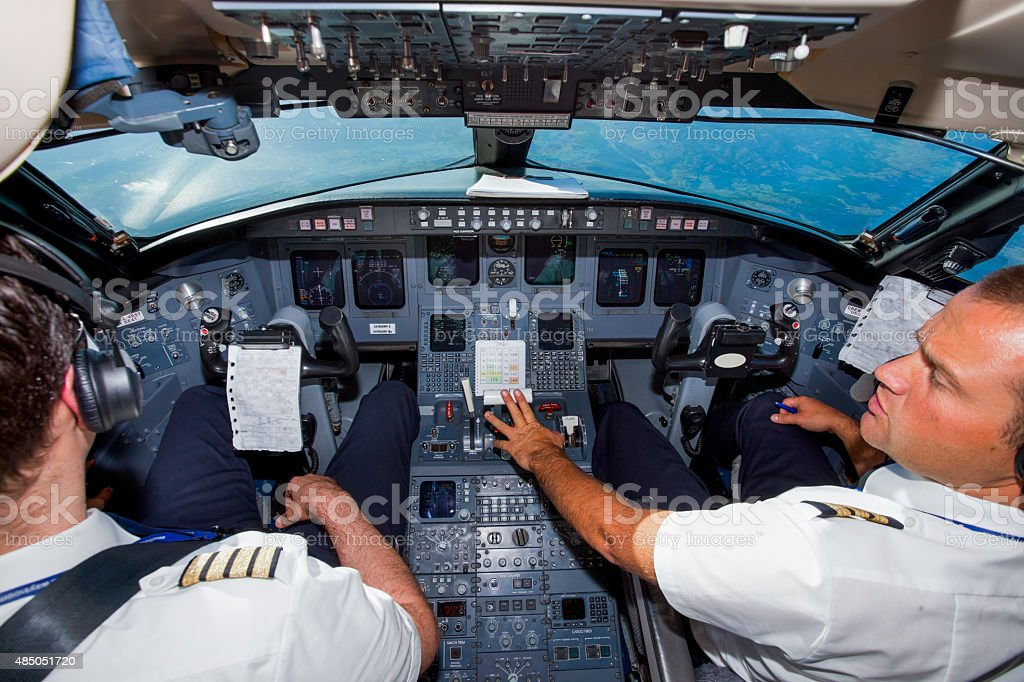 Cockpit of an airplane during a flight,pilot and copilot stock photo