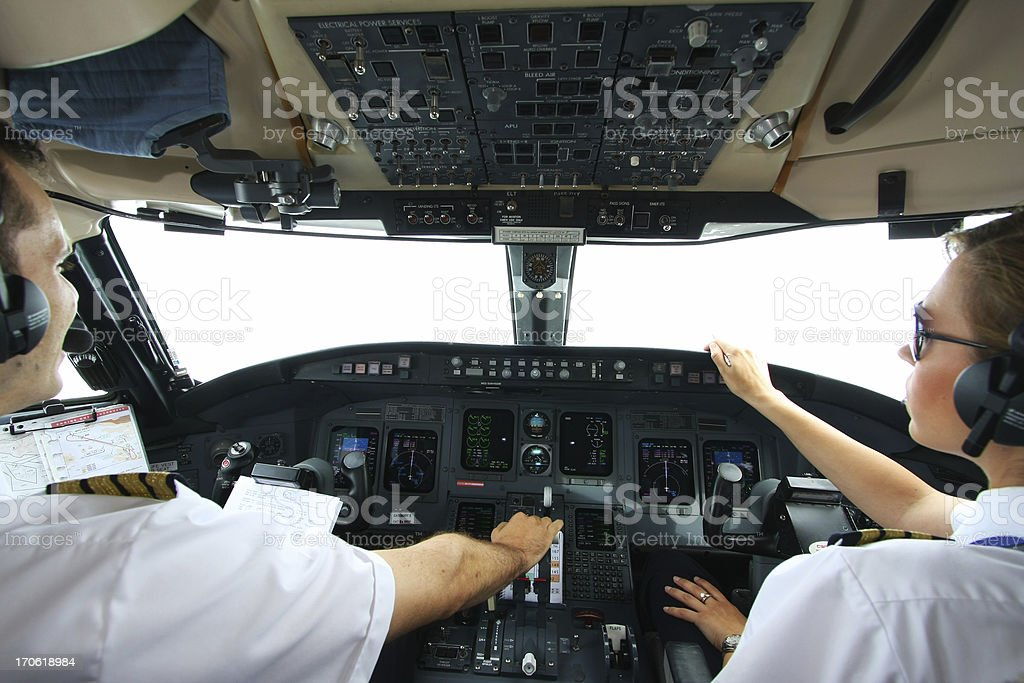 Cockpit of an airplane with young pilots flying royalty-free stock photo