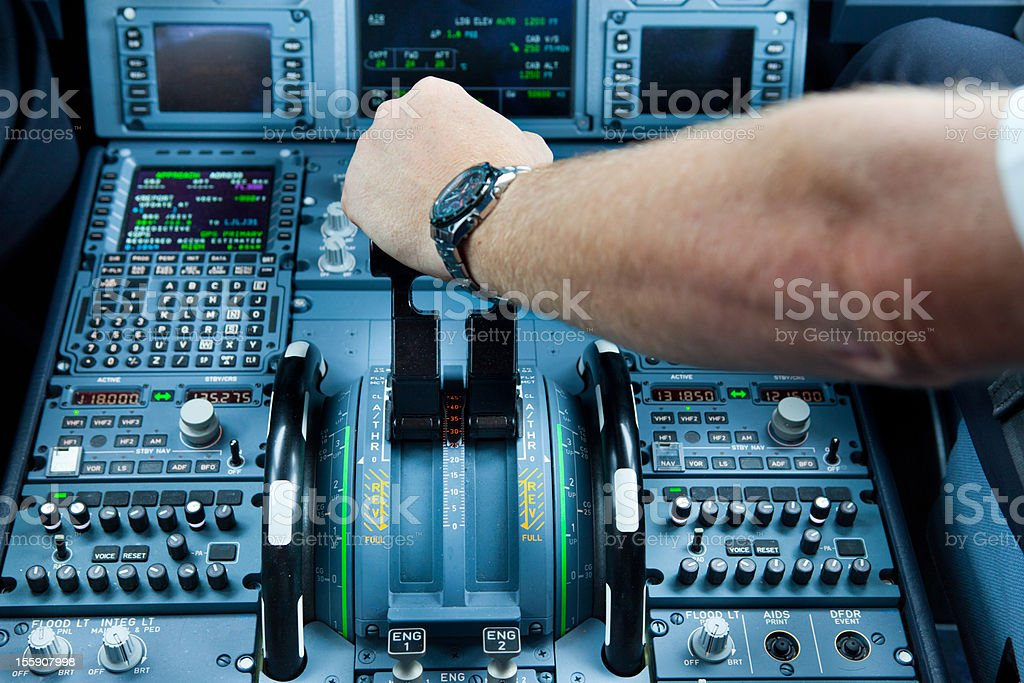 Cockpit of mothern commercial airplane...pilot at work royalty-free stock photo