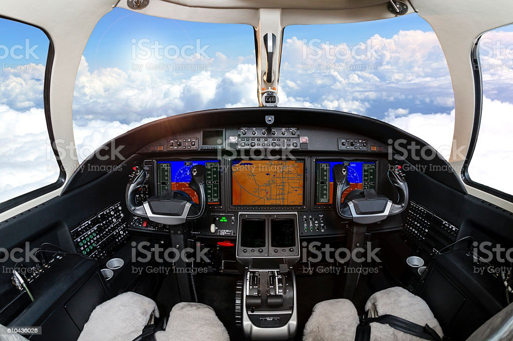 Cockpit view above clouds stock photo